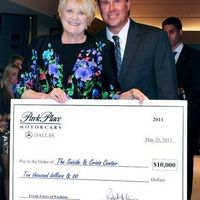 Robert Morris (GM at Park Place) presenting Margie Wright (Executive Director, Suicide and Crisis Center of North Texas) with a $10,000 check